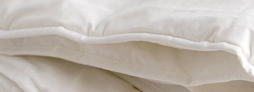 Closeup van de tijk van een wollen dekbed